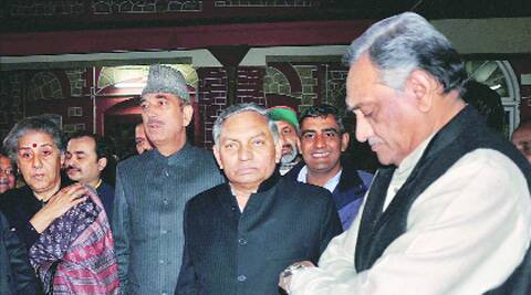 Bahuguna with party observers in Dehradun.