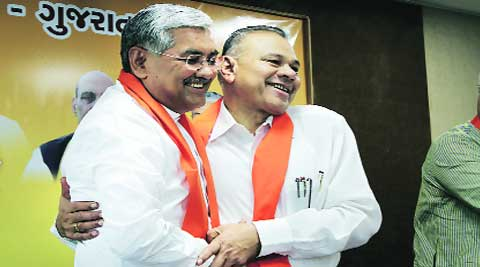 BJP State unit president R C Faldu (left) with GPP president Gordhan Zadaphia in Ahmedabad on Monday. express