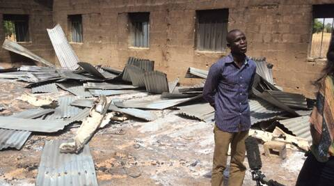Bitrus Samuel, who claims he was in the Church when gunmen attacked speaks to a journalist inside the burned church, in Wada Chakawa, Yola, Nigeria. (AP Photo)