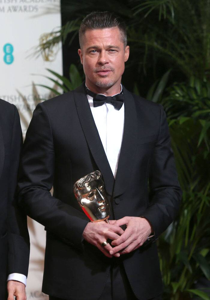 Brad Pitt was happy to be walking away with Best Film for '12 Years A Slave'.