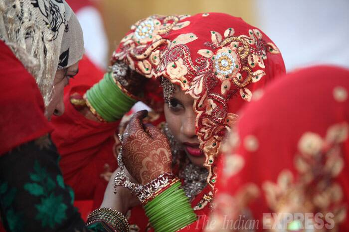 A relative checks on the bride at the ground. (IE photo: Dilip Kagda)