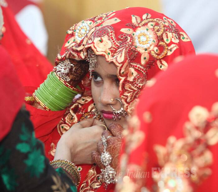 A nervous bride adjusts her attire before the wedding ceremony, (IE Photo: Dilip Kagda)