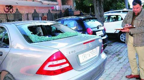 A policeman inspects the vandalised cars in Sector 19 on Wednesday. (Express)