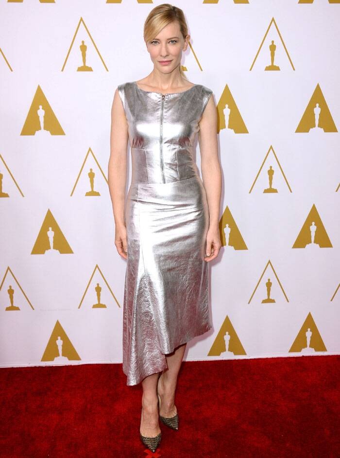 "Cate Blanchett, the favorite to win best actress for her role as a disgraced socialite in Woody Allen's 'Blue Jasmine' was shining in the silver leather outfit. Cate said this nomination ""certainly took me by surprise."" (AP)"