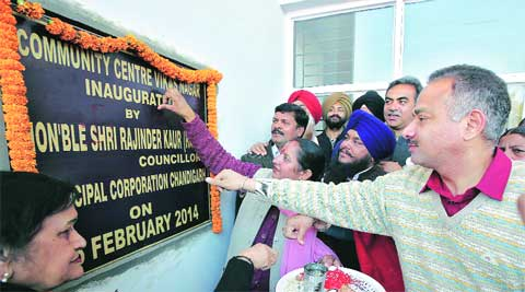 Party president Sanjay Tandon and area councillor Rajinder Kaur inaugurate the Community Centre at Mauli Jagran on Sunday. Kamleshwar Singh