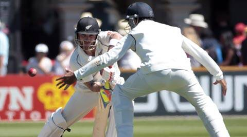 India's Cheteshwar Pujara (R) fields a shot from New Zealand's Brendon McCullum (Reuters)