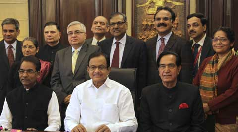 Finance Minister P Chidambaram and his team on the eve of the interim Budget, in New Delhi on Sunday.  (PTI Photo)