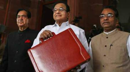 P. Chidambaram, center, shows a briefcase containing interim budget for the fiscal year 2014-15, with state ministers of finance Namo Narain Meena, left, and J.D. Seelam. (PTI photo)