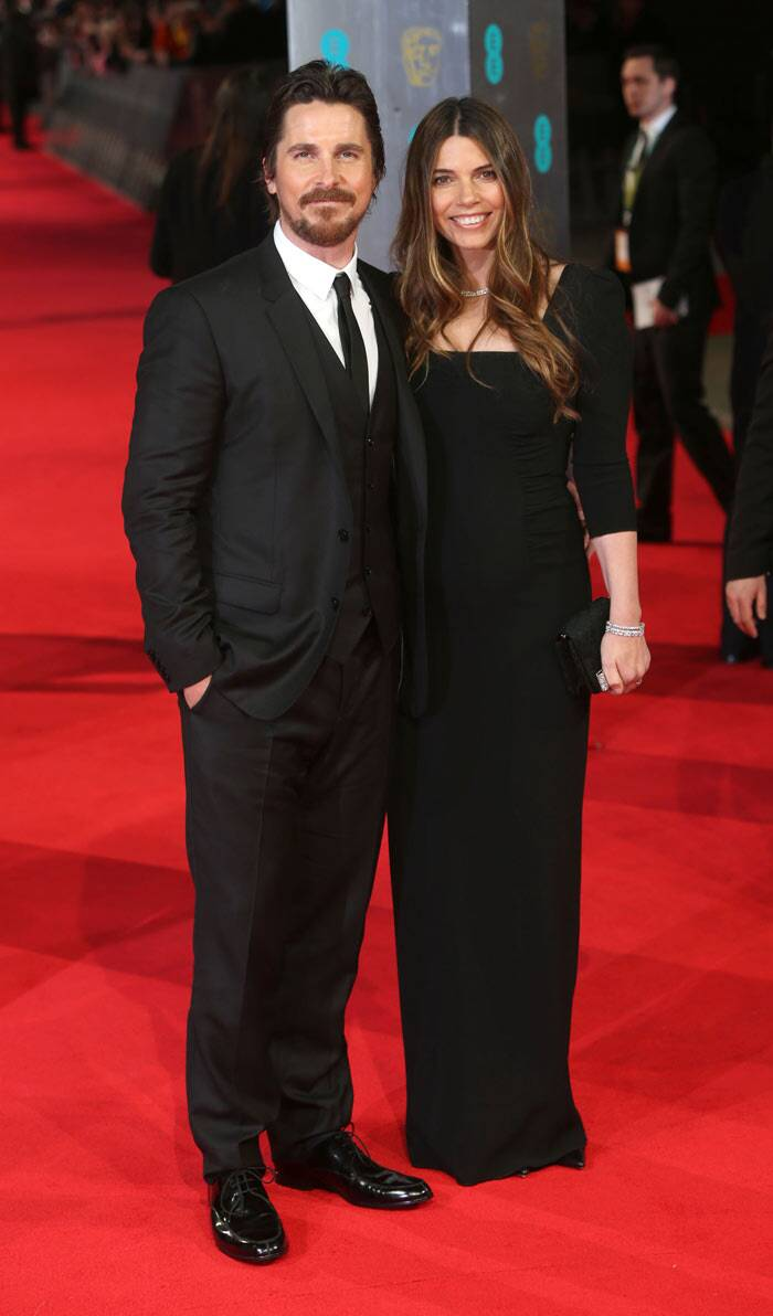 Best Actor nominee, Christian Bale who put up an impressive performance in 'American Hustle', posed with wife Sibi Blazic.