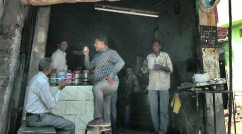Qutubuddin Ansari (with cup in hand) at the tea stall on Tuesday.