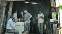 Qutubuddin Ansari (with cup in hand) at the tea stall on Tuesday