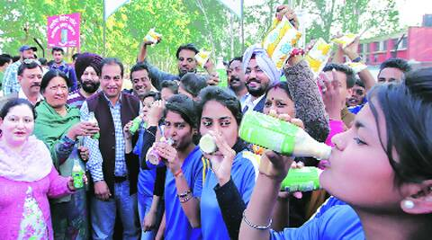 Children enjoy the milk distributed by Congress workers in Sector 19, Chandigarh, on Friday.