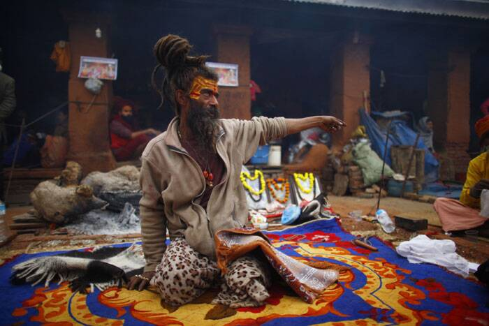 "A sadhu man talks to his devotee during the ""Shivaratri"" festival at the courtyard of the Pashupatinath Hindu temple in Katmandu, Nepal. (AP)"