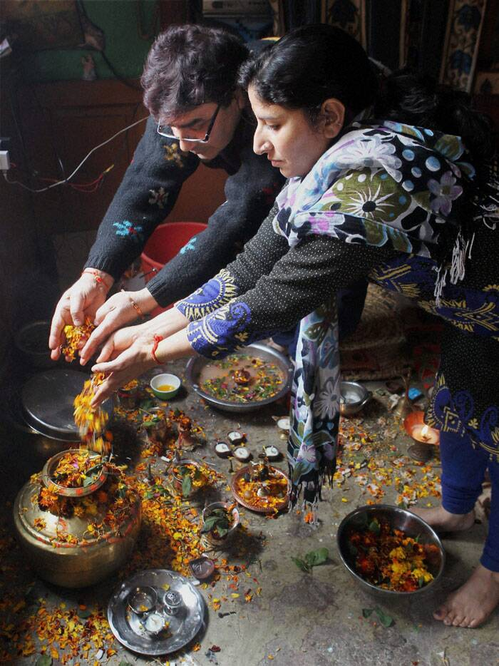 A Kashmiri Pandit Couple performs puja during the celebrations of Maha Shivratri Festival, at Habbal Kadal in Srinagar on Thursday. (PTI)