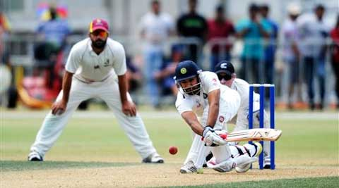 India's Rohit Sharma, right, sweeps against New Zealand XI on the second day of a pre test warm up cricket match. (AP)