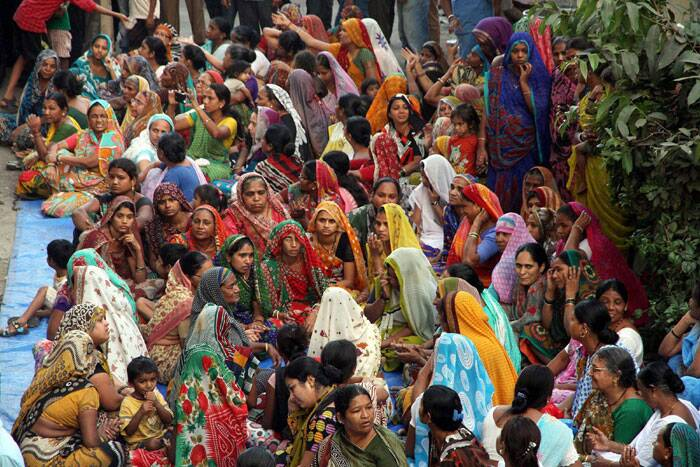 Family members and relatives wait for bodies of to arrive at Thane on Wednesday. (PTI)