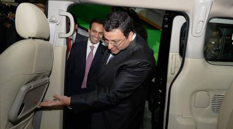 Tata Group Chairman Cyrus Mistry and Ashok Leyland Chairman Dheeraj Hinduja at the Ashok Leyland stall during the 12th Auto Expo 2014 in Greater Noida on Wednesday. (PTI)