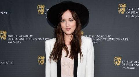 Dakota Johnson says shooting the film with Jamie Dornan and the rest of the cast and crew has been very positive. (Reuters)