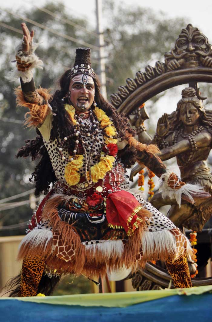 A devotee dressed as God Shiva dances as he participates in a procession on the eve of Shivratri festival, in Jammu. (AP)
