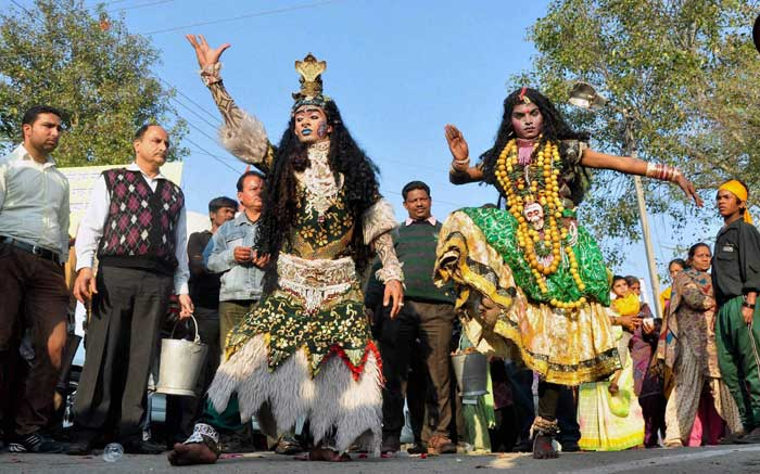 Devotees dressed as Lord Shiva and Goddess Kali take part in a Shobha Yatra on the eve of Maha Shivratri in Patiala. (PTI)