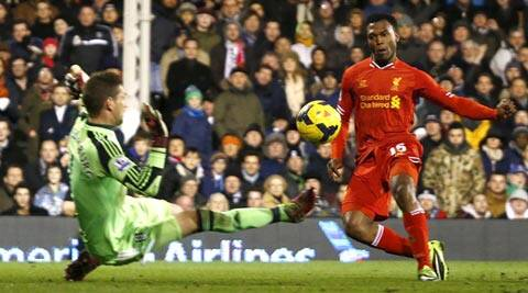 Liverpool's Daniel Sturridge (R) scores a goal against Fulham during their English Premier League soccer match at Craven Cottage in London (Reuters)