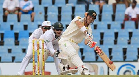 David Warner, right, plays a stroke shot as South Africa's wicketkeeper AB de Villiers, centre, and captain Graeme Smith, left, watch on the third day of the first Test (AP)