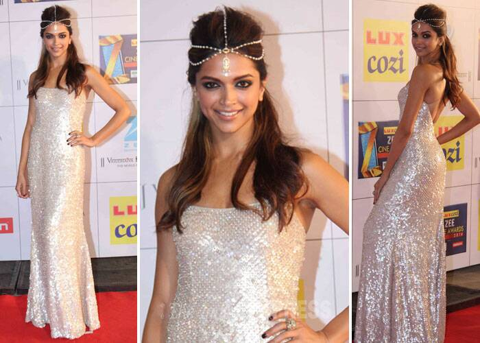 Bollywood glitterati were out for a fun night at the Zee Cine Awards in Mumbai on Saturday (February 8). <br /><br />Bollywood's reigning queen Deepika Padukone was dazzling in a Naeem Khan gown from the designer's Fall 2013 collection. She crowned herself with pearl head-jewellery in sync with her cream sequin gown. We like! (Photo: Varinder Chawla)