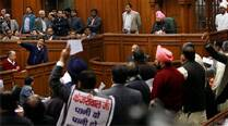 Chief Minister Arvind Kejriwal speaks amid protest by BJP's members in the Delhi Assembly during its special session called for anti-corruption Jan Lokpal Bill. (PTI)
