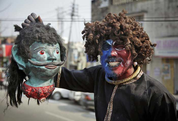 A devotee dressed as a demon participates in a procession on the eve of Shivratri festival, in Jammu. <br /> Shivratri, a festival dedicated to the worship of Hindu God Shiva, will be marked across the country on Thursday. (AP)