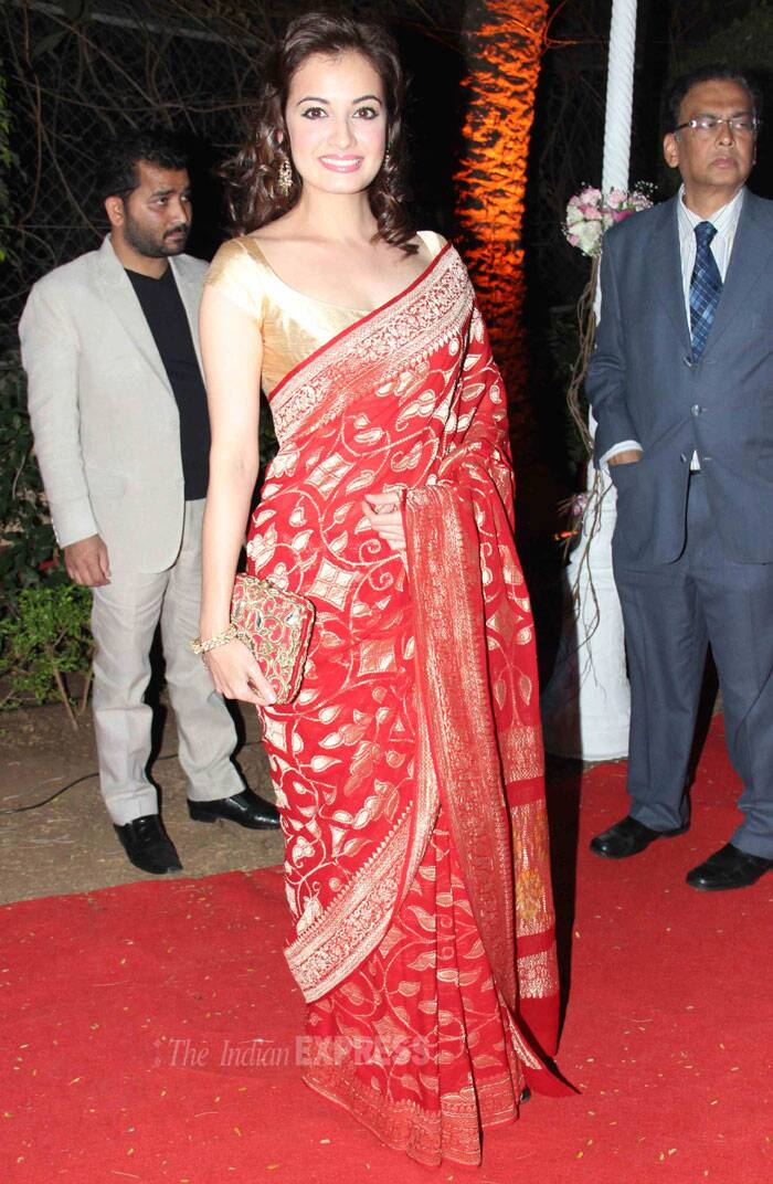 Actress Dia Mirza was all smiles looking pretty in a red sari with a gold blouse and a matching clutch. (Photo: Varinder Chawla)