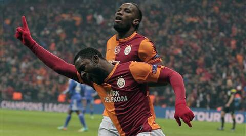 Didier Drogba, rear, and Aurelien Chedjou of Galatasaray during their Champions League Round of 16, First Leg match between Galatasaray and Chelsea at Turk Telekom Arena Stadium in Istanbul, Turkey, Wednesday, Feb. 26, 2014.