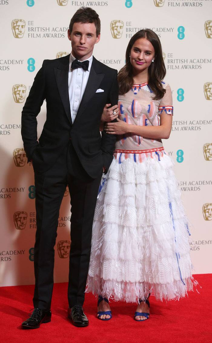 'Les Miserables' star Eddie Redmayne on the red carpet with Swedish actress Alicia Vikander.