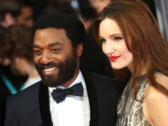 Best Actor winner Chiwetel Ejiofor is all smiles as he arrives with his partner Sari Mercer.