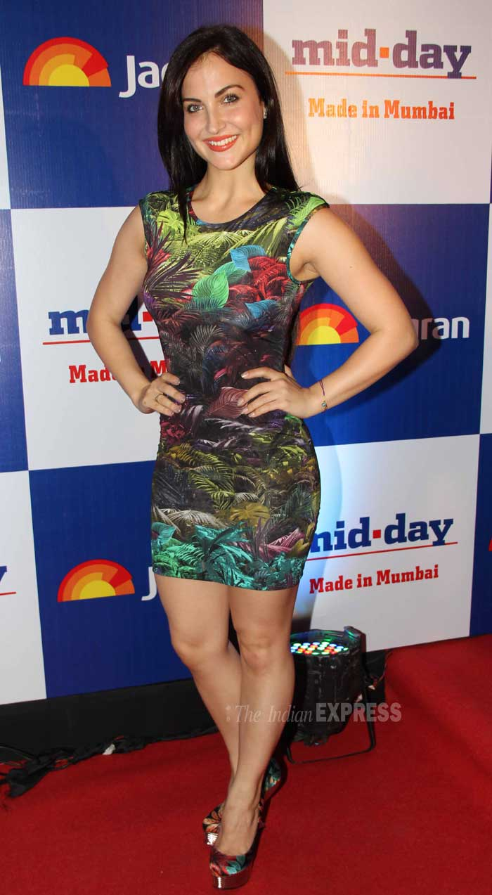 Elli Avram was sassy in a neon short dress with leaf detailing. (Photo: Varinder Chawla)