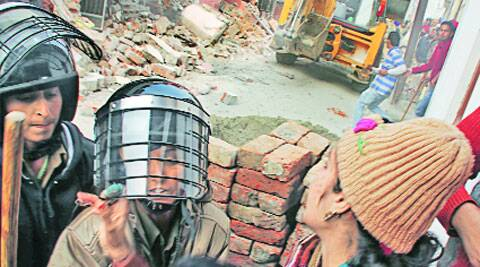 During the demolition drive in Ludhiana on Friday. (IE Photo: Gurmeet Singh)
