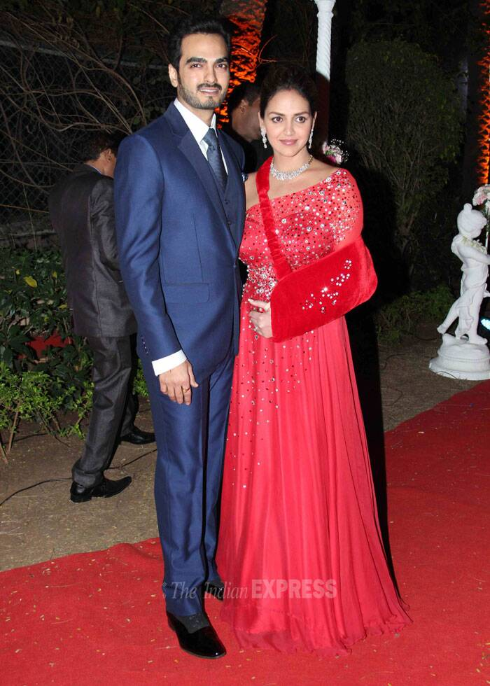 Sister Esha Deol picked a shiny red one-shoulder gown with a matching hand sling, while her husband Bharat Takhtani was handsome in a suit. (Photo: Varinder Chawla)