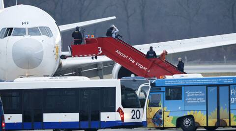 Police stand on the stairs after passengers were evacuated from a hijacked Ethiopian Airlines Plane on the airport in Geneva, Switzerland. (AP)