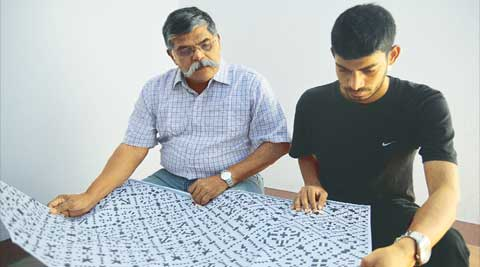 The perfect clue: Deepak Gopinath (left) and Mohsin Ahmed discuss a jumbo crossword. (Kashif Masood)