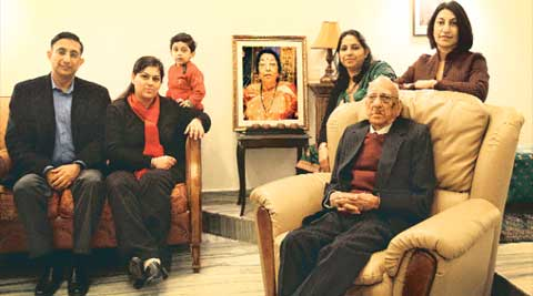 Kapila's family at their home with Nirmal (second from right).