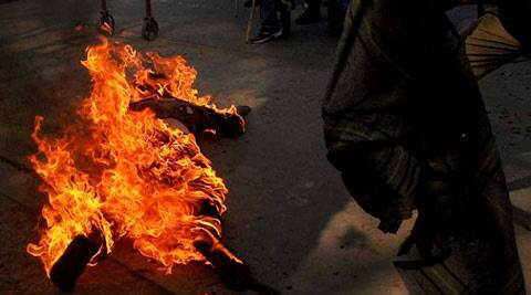 A Krishak Mukti Sangram Samiti (KMSS) activist self-immolates during an agitation to demand land deeds for the people living on the hills, in Guwahati on Monday.