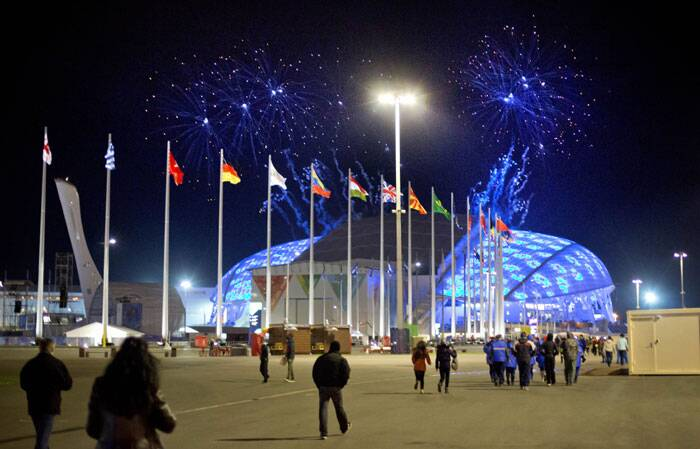 Fireworks are seen as spectators arrive for the rehearsal of the opening ceremony at the Fisht Olympic Stadium at the 2014 Winter Olympics. (AP)