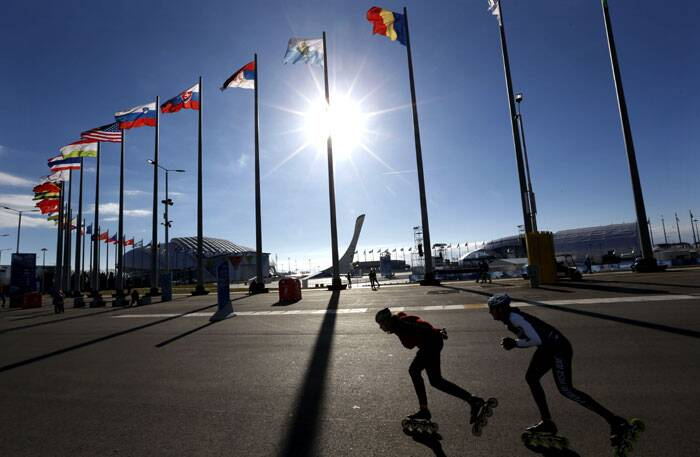 A pair of inline skaters who will perform at the opening ceremony get some exercise at Olympic Park ahead of the 2014 Winter Olympics in Sochi, Russia. (AP)