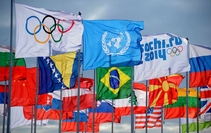 The United Nations flag flies between Olympic flags and the flags of nations participating in the 2014 Winter Olympics in the Athletes Village in Sochi, Russia. (AP)