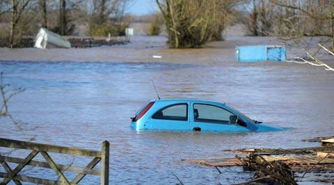 A car stands in the floodwater at Burrowbridge, southwestern England. (AP)
