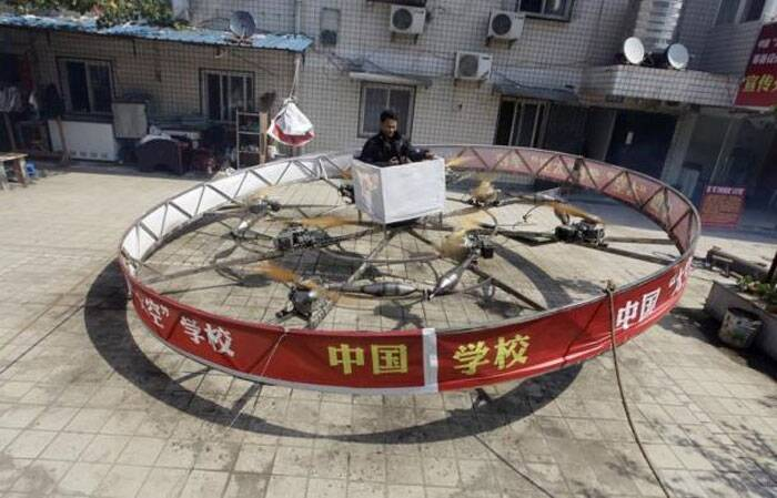 Local farmer Shu Mansheng hovers above the ground in his self-designed and homemade flying device during a test flight in front of his house in Dashu village on the outskirts of Wuhan, Hubei province, China, September 21, 2011. The round steel flying device, which cost more than 20,000 yuan ($3,135), is the fifth model made by Shu, a junior middle school graduate. It measures around 5.5 meters (18 feet) in diameter, and is powered by eight motorcycle engines. Shu managed to hover for 10 seconds at about 1 metre (3.3 feet) above ground during a recent test flight. (Reuters)
