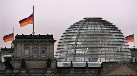The German flag flutters over the Reichstag building. (AP)