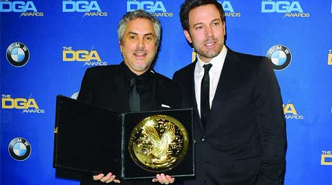 Actor and director Ben Affleck (R) presents Mexican director Alfonso Cuaron with the Feature Film award for Gravity' during the 66th annual Directors Guild of America Awards in Beverly Hills, California January 25, 2014