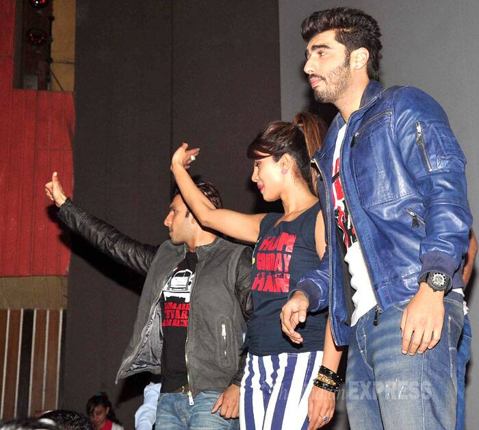 Priyanka and Ranveer wave to fans, while Arjun seems a bit unsure of what to do. (Photo: Varinder Chawla)