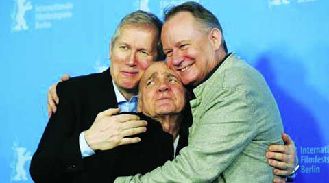 Director Hans Petter Moland and cast members Bruno Ganz and Stellan Skarsgard (L-R) joke during a photocall to promote the movie Kraftidioten (In Order of Disappearance) at the 64th Berlinale International Film Festival in Berlin February 10, 2014