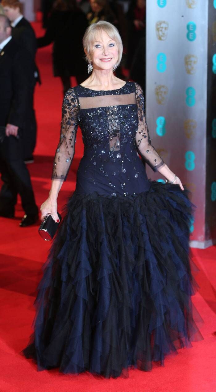 Dame Helen Mirren looked lovely in a black embellished gown with ruffle detailing. (AP)